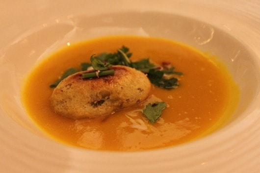 Heirloom squash soup, chestnut bread pudding, truffle syrup and herb salad - Talisker on Main