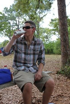 Adam Bartoy sipping on a FLASQ wine